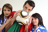 Three passionate Italian soccer fans — Stock Photo