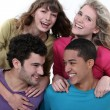 Stock Photo: Elated young foursome of students
