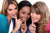 Three woman making shush gesture — Stock Photo