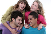 Elated young foursome of students — Stock Photo