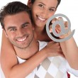 Couple holding at symbol — Stock Photo