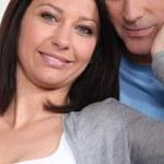 Woman touching husbands face — Stock Photo