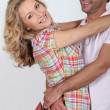 Couple hugging holding shopping bags — Stock Photo #14154379