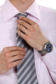 Businessman fixing his tie — Stock Photo