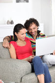 Couple watching a movie on their laptop — Stock Photo