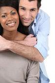 Couple embracing on white background — Stock Photo