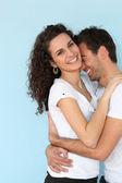 Cheerful couple hugging — Stock Photo