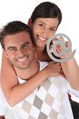 Couple holding at symbol — Stock Photo