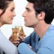 Couple having a glass of champagne — Stock Photo