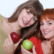 Women holding apples — Stock Photo