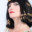 Stock Photo: Womdressed as Cleopatra