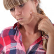 Blond woman touching her cheek — Stock Photo