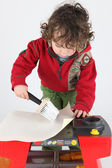 Little boy wall papering — Stock Photo