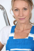 Woman in overalls — Stock Photo