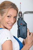 Closeup of smiling lady with electric drill — Stock Photo