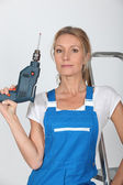 Woman posing with a drill — Stock Photo