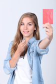 Girl showing red car — Stock Photo