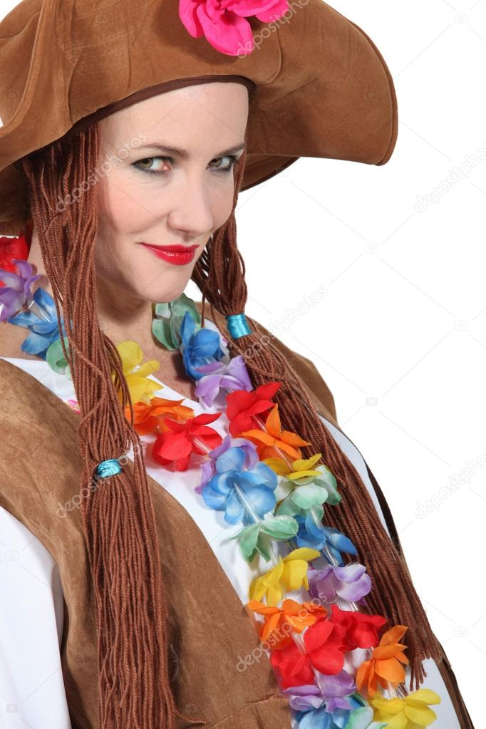 Woman wearing brown hat and wig with flowers around neck — Stock Photo #14168886