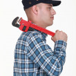 Builder carrying wrench over shoulder — Stock Photo #14171365