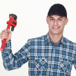 Man with an adjustable wrench — Stock Photo #14171391