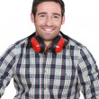Stock Photo: Mwearing protecting ear muffs