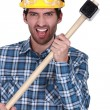 Angry construction worker with a sledgehammer — Stock Photo