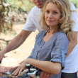 Couple riding a bike — Stock Photo #14171912