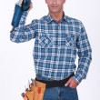 Stock Photo: Mholding angle grinder