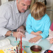 Grandfather with grandson drawing — Stock Photo