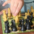 Close-up of little boy playing chess — Stock Photo