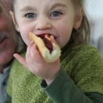 Little girl eating breakfast — Stock Photo