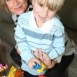 Mother and son playing with building blocks — Stock Photo