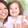 Mother and daughter with a dolly — Stock Photo
