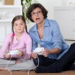 Mother and daughter playing video games — Stock Photo #14175382