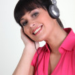 Cheerful woman with listening to music — Stock Photo #14175856