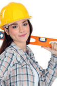 Female construction worker with a level. — Stock Photo