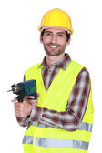 Construction worker with a power drill — Stock Photo
