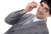 Businessman removing glasses — Stock Photo
