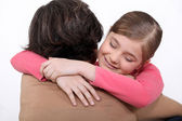 A mother hugging her daughter. — Stock Photo