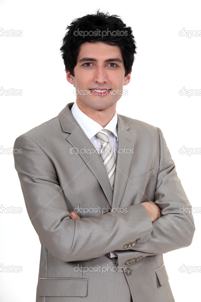 Portrait of young businessman in a suit — Stock Photo #14172298