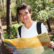 Young man holding a map — Stockfoto