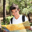 Portrait of a young man with map - Stockfoto
