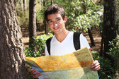Young man holding a map — Stock Photo