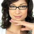 Stock Photo: Portrait of young womwearing glasses