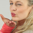 Blonde woman with files blowing a kiss — Stock Photo #14237379