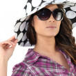 Stock Photo: Brunette wearing summery hat and sunglasses