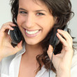 Woman with bright smile listening to music - Foto de Stock