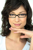 Portrait of a young woman wearing glasses — Stock Photo