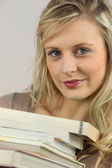 Woman with a stack of books — Stock Photo