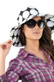 Brunette wearing summery hat and sunglasses — Stock Photo